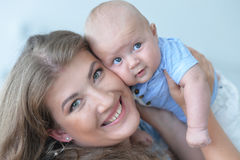 Woman with baby boy Stock Images