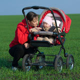 Woman with baby buggy Royalty Free Stock Image