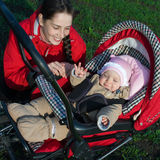 Woman with baby buggy Royalty Free Stock Photos