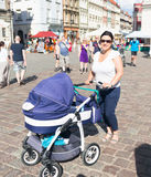 Woman with baby buggy Stock Images
