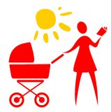 Woman and baby carriage Stock Photos
