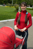 Woman with baby carriage Royalty Free Stock Images