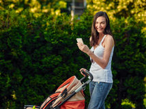 Woman With Baby Carriage Using Cell Phone Stock Photo