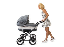 Woman with baby carriage. Young woman with baby carriage Royalty Free Stock Photography