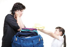 Woman and daughter hand crammed full of clothes and shoulder bag Royalty Free Stock Photos