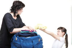Woman and daughter hand crammed full of clothes and shoulder bag Royalty Free Stock Photo