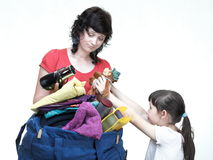Woman and daughter hand crammed full of clothes and shoulder bag Royalty Free Stock Images