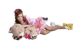 Woman baby doll dress. Pretty woman in pink baby doll dress playing with toys Royalty Free Stock Photo