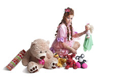 Woman baby doll dress. Pretty woman in pink baby doll dress playing with toys Royalty Free Stock Photos