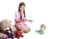 Woman baby doll dress. Pretty woman in pink baby doll dress playing with toys Royalty Free Stock Image