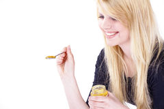 Woman with baby food in glass Royalty Free Stock Photography