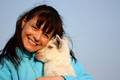 Woman with baby goat (kid) royalty free stock photos