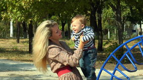 A woman with a baby in her arms stock video footage