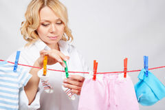 Woman with baby laundry Stock Image