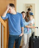 Woman with baby leaving home Royalty Free Stock Photography