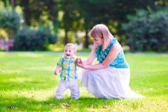 Woman and baby in a park Royalty Free Stock Image