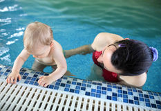 Woman with baby in pool Royalty Free Stock Photography