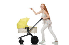 The woman with baby and pram isolated on white Stock Photography