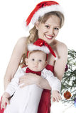 Woman and baby in red christmas hats Stock Image