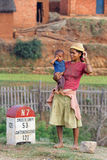Woman and baby on the road Royalty Free Stock Photos