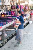 Woman with baby at a roadside hill tribe market, Chiang Rai province, Thailand. Chiang Rai, Thailand - December 10th 2014: Woman with baby at a roadside hill royalty free stock images