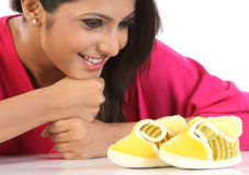 Woman   with baby shoes Stock Photos