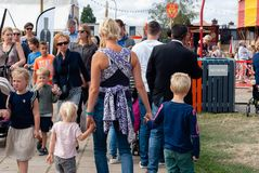 Mother with three small childeren at a festival royalty free stock photo