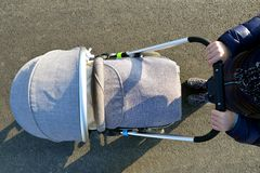 Woman with baby stroller. royalty free stock photo