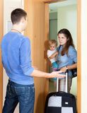 Woman with baby and suitcase Stock Photos