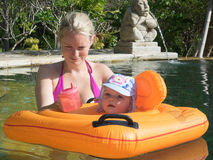 Woman and baby in a swimming pool, bali Royalty Free Stock Image