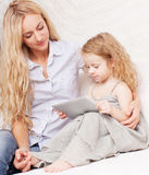 Woman and baby with tablet computer Stock Photography