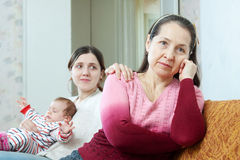 Woman with baby tries reconcile with her mother Royalty Free Stock Images