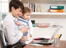 Woman With Baby Working From Home Royalty Free Stock Photo