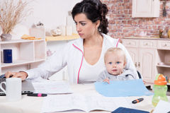Woman With Baby Working From Home Royalty Free Stock Photography