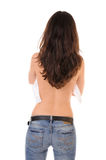 Woman back. Back of woman in jeans and unhooked bra with long hair isolated on white background Stock Images