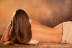 Woman back. Beautiful woman back lie in spa salon Royalty Free Stock Photography