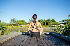 Woman back with arms in yoga asana position Stock Photo