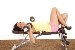 Woman back bench weights smile Royalty Free Stock Image