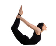 Woman back bends yoga - bow pose isolated Stock Photo