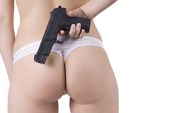 Woman back bottom and gun in lingerie Royalty Free Stock Photos