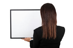 Woman  holding a frame. Royalty Free Stock Photography