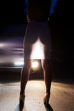 Woman back dress in light of headlights cars Royalty Free Stock Photo