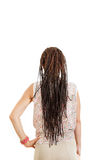Woman with back facing away from camera with extended braids ha Royalty Free Stock Photography