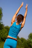 Woman back during fitness in the country Stock Photography