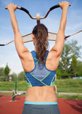 Woman back, girl exercise outdoors Stock Images