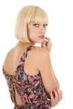 Woman back look over shoulder hand mouth Stock Photo