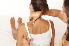 Woman back massage Stock Photography