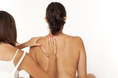 Woman back massage Stock Photo