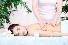 Woman on back massage. Pretty woman on back massage in spa center Stock Image