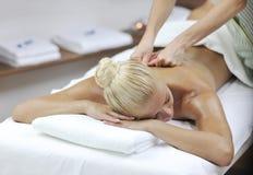 Woman back massage treatment Royalty Free Stock Photo